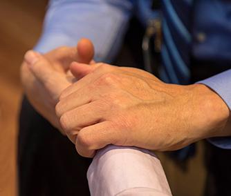Dr. Plotnikoff taking patient's pulse